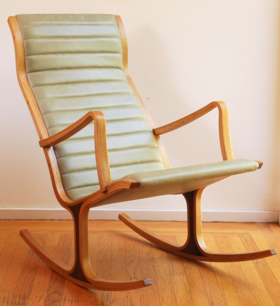 Tendo Mokko Heron rocking chair, following reupholstery in semi-aniline sage green leather.